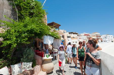 SANTORINI,OIA-JULY 28: Tourists on the Oia street on July 24,2018 in Oia town on the Santorini island, Greece.