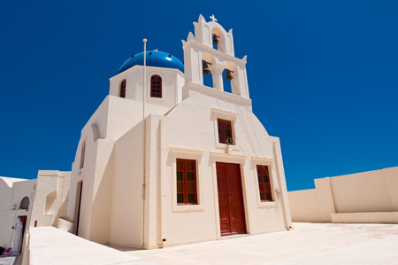 Church facade in Oia. Santorini, Greece. photo