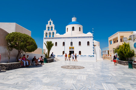 SANTORINI,OIA-JULY 28: The Church of Agia Irini on July 28,2014 in Oia village on the Santorini island, Greece. Oia is a small town on the islands of Thira (Santorini) and Therasia, Greece.