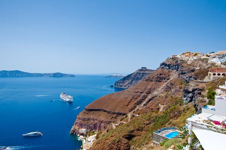 Fira landscape and skyline on the edge of caldera. Thira (Santorini), Greece. photo