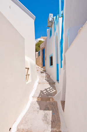 thira: Narrow street in Fira town on Santorini (Thira), Greece.