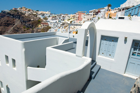 caved: Typical caved house with patio in Fira town on the Santorini (Thira) island in Greece. Stock Photo