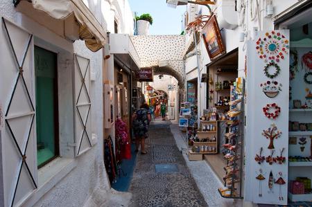 SANTORINI,FIRA-JULY 28: Shopping street with souvenirs shops on July 28,2014 in Fira town on the Santorini island, Greece. Fir? is the modern capital of the Greek Aegean island, Santorini.