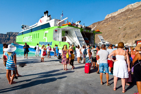 SANTORINI-JULY 28: Group of tourists leave the Santorini on July 28, 2014 from the port of Thira. Santorini, Greece.