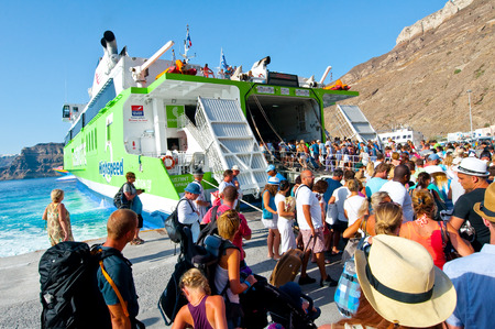 thira: Tourists leave the Santorini on July 28, 2014 from the port of Thira. Santorini, Greece. Editorial