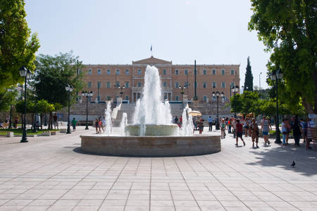syntagma: ATHENS-AUGUST 22: Syntagma Square and Parliament building on the background on August 22, 2014 in Athens, Greece.