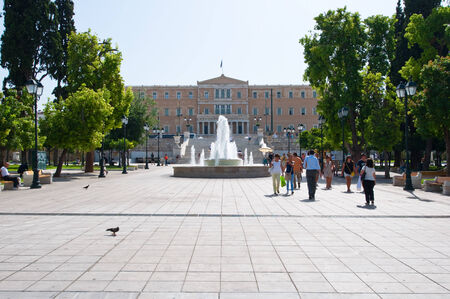 syntagma: ATHENS-AUGUST 22: Syntagma Square with Greece Parliament building on August 22, 2014 in Athens, Greece.