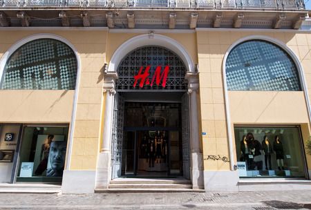 ATHENS-AUGUST 22: H&M store building on Emrou street on August 22,2014 Athens, Greece. H & M is a Swedish retail-clothing company, known for its fast-fashion clothing for men, women, and children.