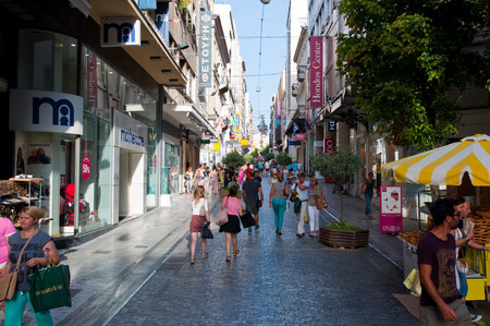 ATHENS-AUGUST 22: Shopping on Ermou Street with various shops on August 22, 2014 in Athens, Greece. Ermou street is a main shopping street in Athens.