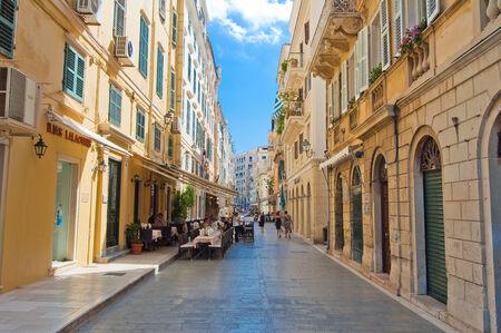 kerkyra: CORFU-AUGUST 22: Venetian architecture in Kerkyra with the row of local restaurants on August 22, 2014 on Corfu island, Greece.