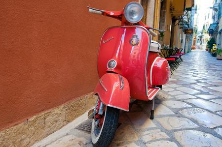 CORFU-AUGUST 22: Vespa scooter on Kerkyra street on August 22, 2014 on Corfu island. Greece. Vespa is an Italian brand of scooter manufactured by Piaggio.