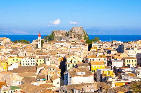 CORFU-AUGUST 22:Corfu cityscape with the Saint Spyridon Church bell tower in the distance seen from the New Fortress on August 22, 2014 on Corfu island, Greece. photo