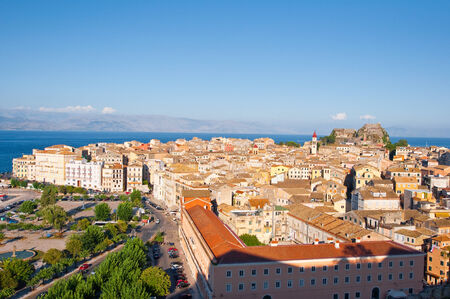 CORFU-AUGUST 22: Aerial view of Corfu city with the Old Fortress on the background from the New Fortress on August 22, 2014 on Corfu island, Greece. photo