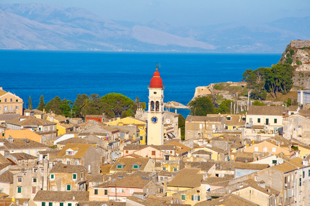 CORFU-AUGUST 22: Corfu city and the bell tower of the Saint Spyridon Church from the New Fortress on August 22, 2014 on Corfu island, Greece. photo