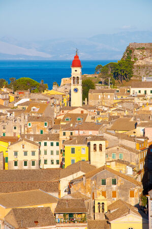 Panoramic view the city of Corfu and the bell tower of the Saint Spyridon Church from the New Fortress on August 22, 2014 on Corfu island in Greece. photo