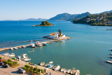 Panorama of Chalikiopoulou Lagoon and Pontikonisi and Vlacheraina monastery seen from the hilltop of Kanoni on the island of Corfu, Greece. photo