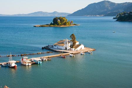 Pontikonisi and Vlacheraina monastery seen from Kanoni on the island of Corfu, Greece. photo