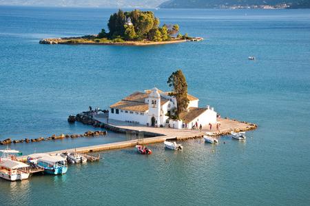 Vlacheraina monastery as seen from Kanoni on the Chalikiopoulou Lagoon on the island of Corfu, Greece. photo