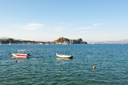 The Old Fortress of Corfu and the boats on the water as seen from the shore. Greece photo