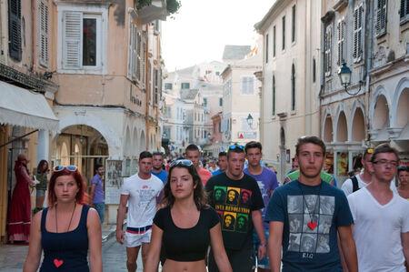 kerkyra: CORFU-AUGUST 22: Kerkyra narrow street in the hot weather with the row of souvenirs shops on August 22, 2014 on Corfu island, Greece.