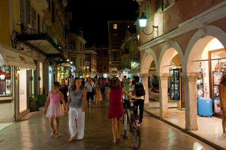 kerkyra: CORFU-AUGUST 25: Crowd of tourists on Kerkyra street at night on August 25, 2014 in Kerkyra town on the Corfu island, Greece.