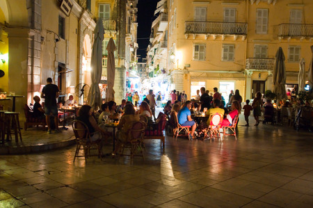 kerkyra: CORFU-AUGUST 25: Tourists have dinner in a local restaurant at night on August 25, 2014 in Kerkyra town on the Corfu island, Greece.