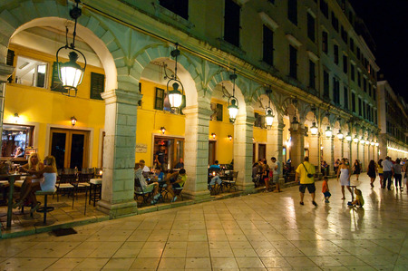 CORFU-AUGUST 22: The Liston of Corfu at night in Kerkyra city with the row of local restaurants on August 22, 2014 on Corfu island, Greece.