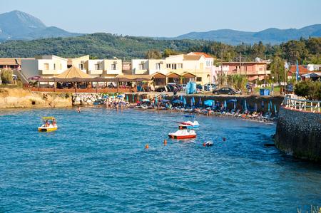 CORFU-AUGUST 26: Sidary resort, people sunbath on the sandy beach on August 26,2014 on the Corfu island, Greece.