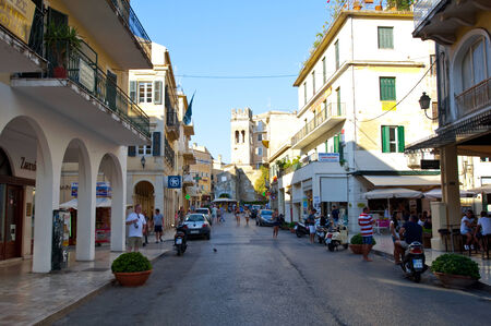 kerkyra: CORFU-AUGUST 27: Kerkyra old town in the midday with the row of souvenirs shops on August 27, 2014 on Corfu island, Greece. Editorial