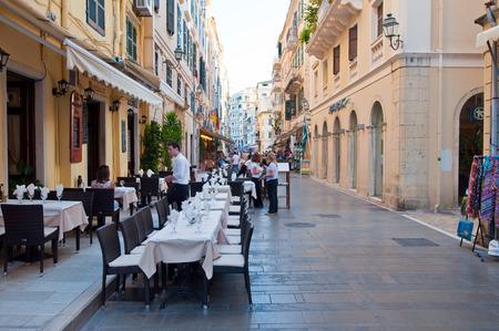 kerkyra: CORFU-AUGUST 22: Kerkyra city, local restaurants invite tourists to have a meal on August 22, 2014 on Corfu island, Greece. Editorial