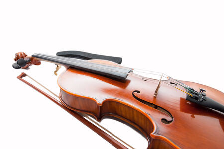 fiddlestick: Classic violin with the fiddlestick isolated on white.