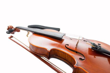 fiddlestick: Viol�n cl�sico con el arco de viol�n aislado en blanco. Foto de archivo