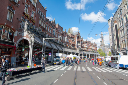 thoroughfare: AMSTERDAMNETHERLANDSAPRIL 27: Raadhuisstraat street on King39s Day with Westerkerk on the background on April 272 015 in Amsterdam. Raadhuisstraat is the main thoroughfare into Old Centre.