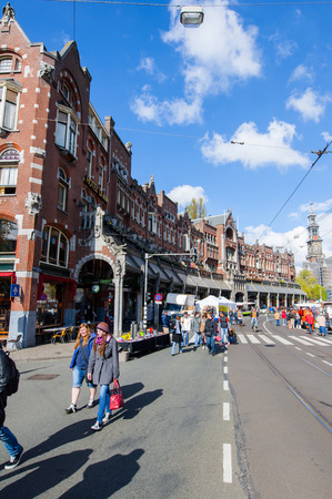 westerkerk: AMSTERDAMNETHERLANDSAPRIL 27: Raadhuisstraat street during King39s Day with Westerkerk on the background on April 272 015 in Amsterdam. Raadhuisstraat is the main thoroughfare into Old Centre. Editorial