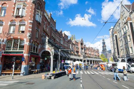 broach: AMSTERDAMNETHERLANDSAPRIL 27: Raadhuisstraat street on King39s Day with Westerkerk broach on the background on April 272 015 in Amsterdam. Raadhuisstraat is the main thoroughfare into Old Centre.