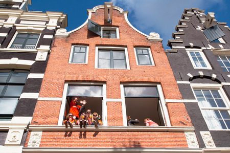 local 27: AMSTERDAMNETHERLANDS APRIL 27: Local youth celebrate King39s Day in city center on April 27 2015 in Amsterdam Netherlands. King39s Day is the biggest street party of the year.