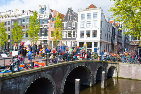 local 27: AMSTERDAMNETHERLANDSAPRIL 27: Local people put up their things for sale on King39s Day on April 27 2015 in Amsterdam Netherlands.