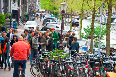 local 27: AMSTERDAMNETHERLANDSAPRIL 27: Company of local people celebrate King39s Day on April 272 015 in Amsterdam the Netherlands. The King Day is celebrated every year in April 27.