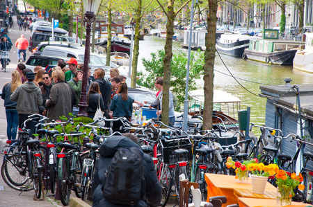 local 27: AMSTERDAMNETHERLANDSAPRIL 27: Groupe of local people celebrate King39s Day on April 272 015 in Amsterdam the Netherlands. The King Day is celebrated every year in April 27. Editorial