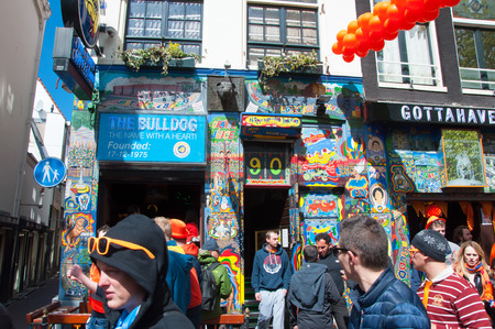 coffeeshop: AMSTERDAM NETHERLANDS APRIL 27: Bulldog coffeeshop in redlight district on King39s Day on April 272015 in Amsterdamthe Netherlands. King39s Day is the largest openair festivity in Amsterdam. Editorial