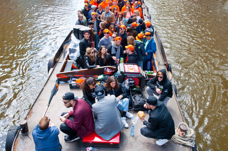 revellers: AMSTERDAM NETHERLANDSAPRIL 27: Party Boat with unlimited beer soda and wine aboard on King39s Day on April 272015. Kings Day is biggest festival celebrating the birth of Dutch royalty. Editorial