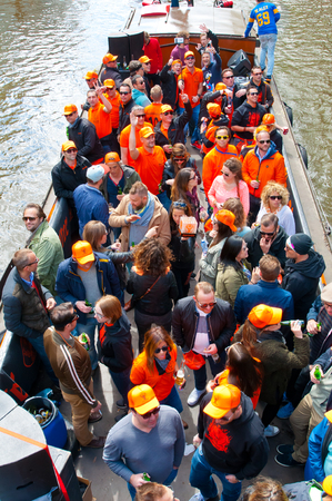 boat party: AMSTERDAM APRIL 27: Boat party through Amsterdam canals with unlimited beer during King39s Day on April 272015 the Netherlands. Kings Day is biggest festival celebrating the birth of Dutch royalty. Editorial