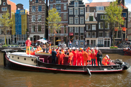 boat party: AMSTERDAM NETHERLANDS APRIL 27: Boat party on Amsterdam canal during King39s Day on April 272 015 in Amsterdam. King39s Day is the largest openair festivity in Amsterdam the Netherlands.