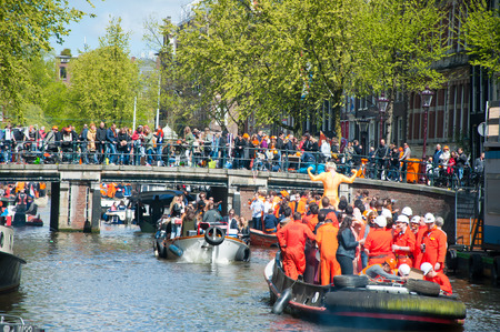 boat party: AMSTERDAM APRIL 27: Boat party through Amsterdam canals with unlimited beer on King39s Day on April 272015 the Netherlands. King39s Day is the largest openair festivity in Amsterdam the Netherlands. Editorial