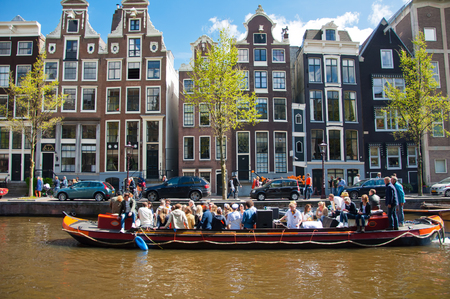 revellers: AMSTERDAM NETHERLANDS APRIL 27: Party Boat with unlimited beer soda and wine aboard on King39s Day on April 272015. King39s Day is the largest openair festivity in Amsterdam the Netherlands.