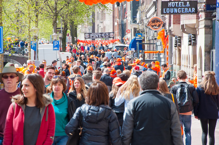 red light district: AMSTERDAM NETHERLANDS APRIL 27: Busy street around red light district on King39s Day on April 2727 in Amsterdam. King39s Day is the largest openair festivity in Amsterdam.