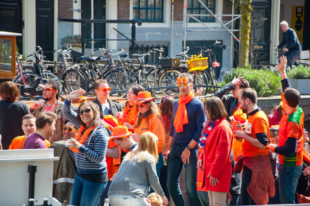 boat party: AMSTERDAM APRIL 27: Boat party on Amsterdam canal during King39s Day on April 272 015 in Amsterdam the Netherlands. Kings Day is biggest festival celebrating the birth of Dutch royalty.