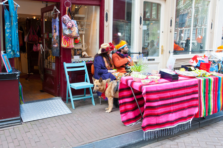local 27: AMSTERDAM,NETHERLANDS-APRIL 27:  Local people display their things for sale on Kings Day on April 27, 2015 in Amsterdam, Netherlands. Kings Day is the largest open-air festivity in Amsterdam. Editorial