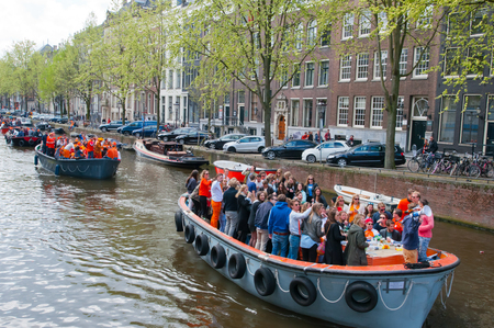 boat party: AMSTERDAM APRIL 27: Boat party during King39s Day on April 272 015 in Amsterdam. King39s Day is the largest openair festivity in Amsterdam.