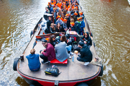 boat party: AMSTERDAM NETHERLANDS APRIL 27: People on Party Boat with unlimited beer soda and wine aboard on King Day on April 27 2015. King Day is biggest festival celebrating the birth of Dutch royalty. Editorial
